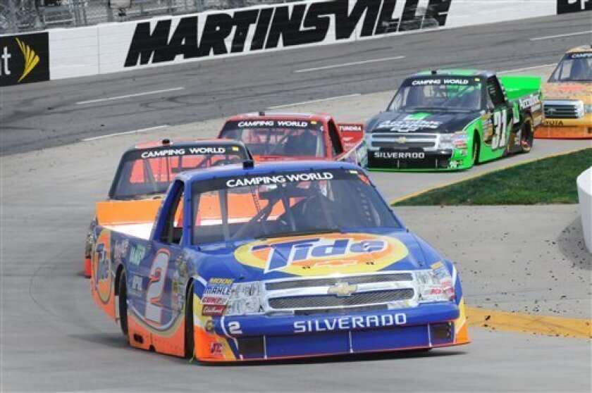 Kevin Harvick leads during the NASCAR Camping World Truck Series auto race, Saturday, March 31, 2012. (AP Photo/Don Petersen)