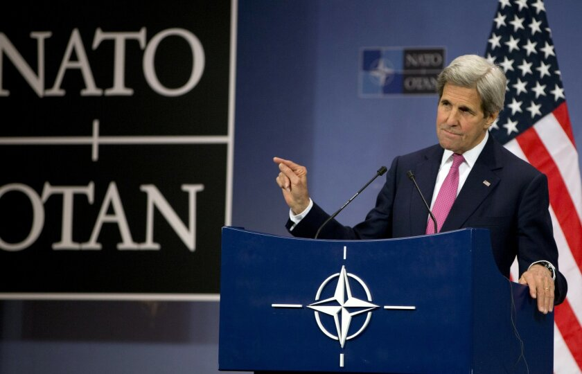 U.S. Secretary of State John Kerry speaks during a media conference at NATO headquarters in Brussels on Thursday, May 19, 2016. NATO foreign ministers this week will discuss how the alliance can deal more effectively with security threats outside Europe, including by training the Iraqi military and cooperating with the European Union to choke off people-smuggling operations in the central Mediterranean. (AP Photo/Virginia Mayo)