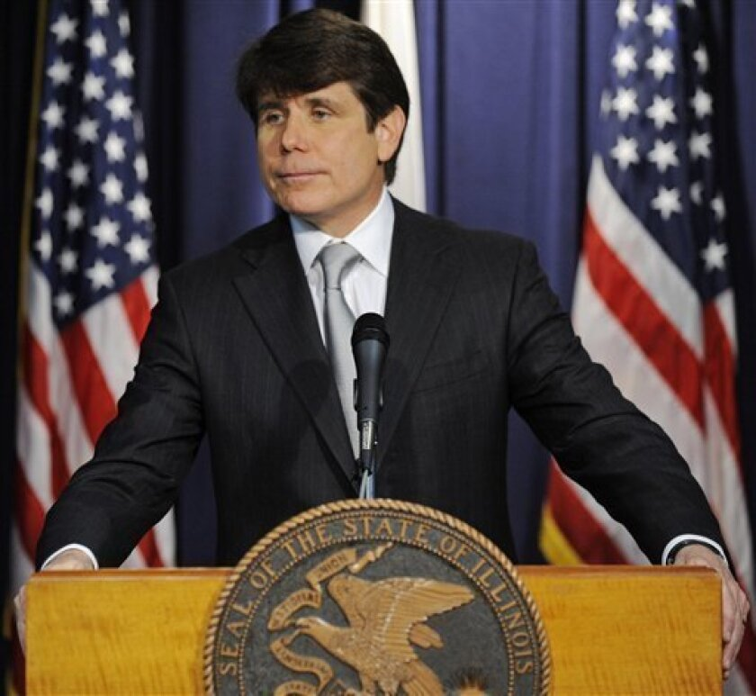 Friday,  Jan. 9, 2009, Illinois Gov. Rod Blagojevich makes a statement at a news conference  in Chicago, after he was impeached by the Illinois House on a wide array of offenses including criminal corruption and wasting taxpayers money. (AP Photo/Paul Beaty, File)