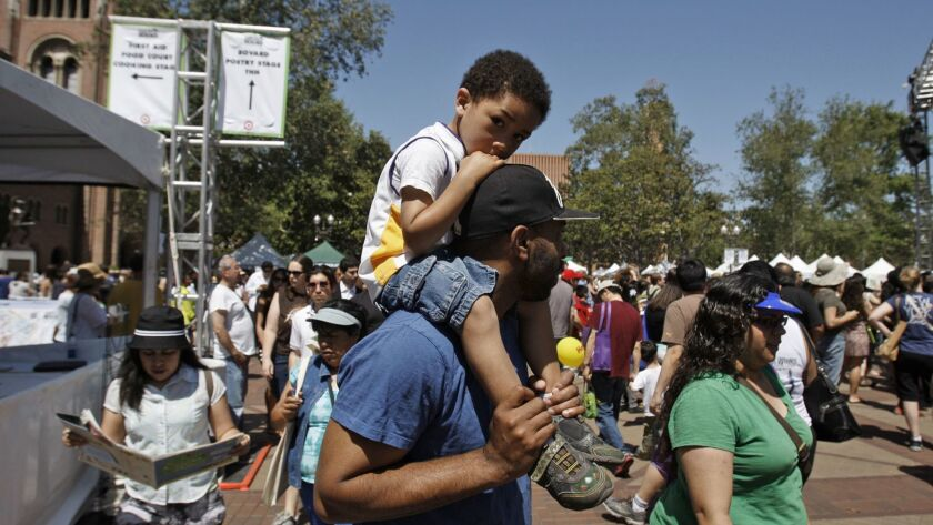 LOS ANGELES, CALIFORNIA: APRIL 20, 2013: Collin Hinds holds his son Preston Hinds, 4, during the 201