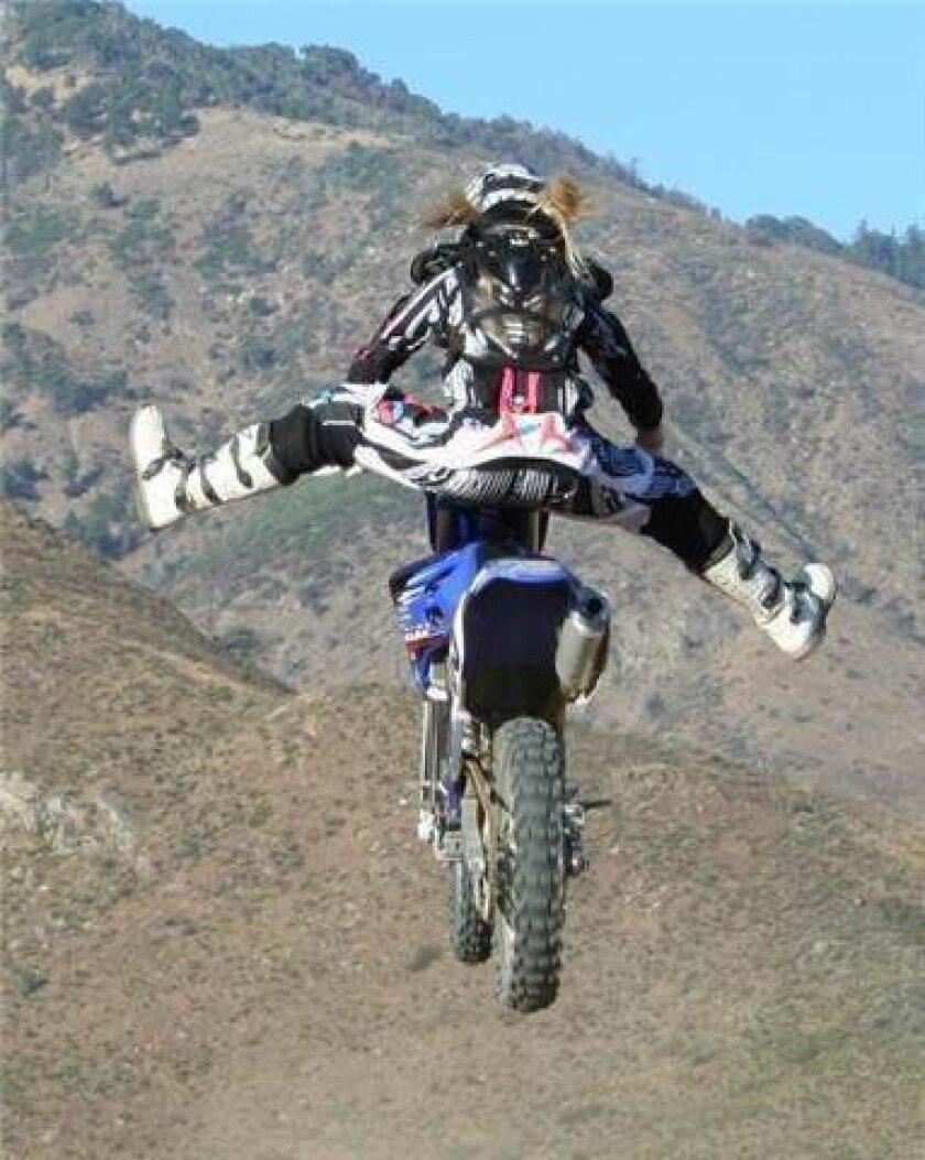 Motocross racer Kayla Kahn bounds through the air.