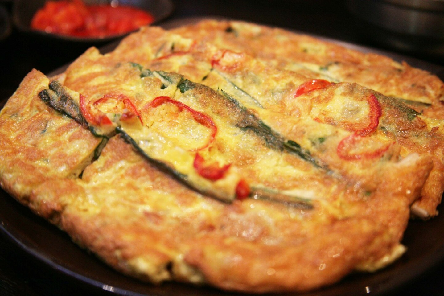 The haemul pajeon (seafood pancake) is a generously thick pancake, made with more than the usual amount of eggs in the batter.