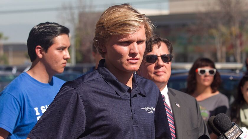 Suspended student Caleb O'Neil appears during a news conference at Orange Coast College.