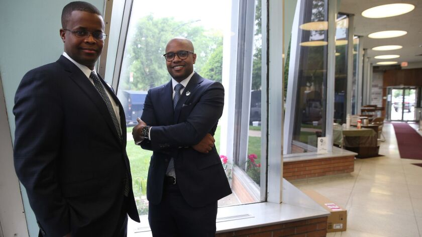 Kweku Nduom, left, and brother Chiefy Nduom have overseen their family's investment in Illinois Service Federal Savings and Loan Association.