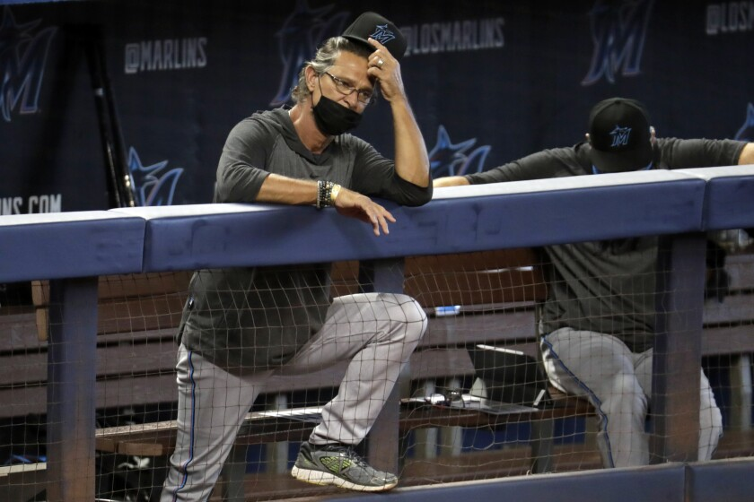 Miami manager Don Mattingly watches a scrimmage at Marlins Park on July 12