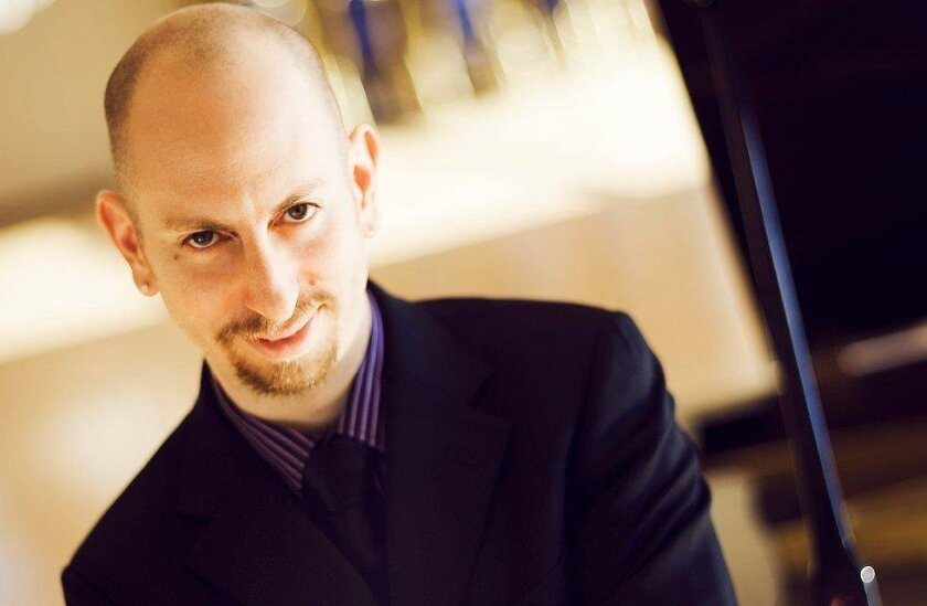"""Soloist Adam Neiman,who performed Saint-Saën's """"Piano Concerto No. 2 in G minor,"""" was calm and assured in the first movement, maniacal in the second and third."""