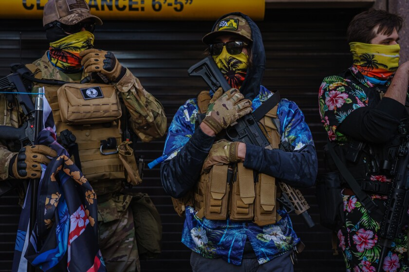 Boogaloo Bois armed with weapons and flags rally during lobbying day in Richmond, Va., on Monday.