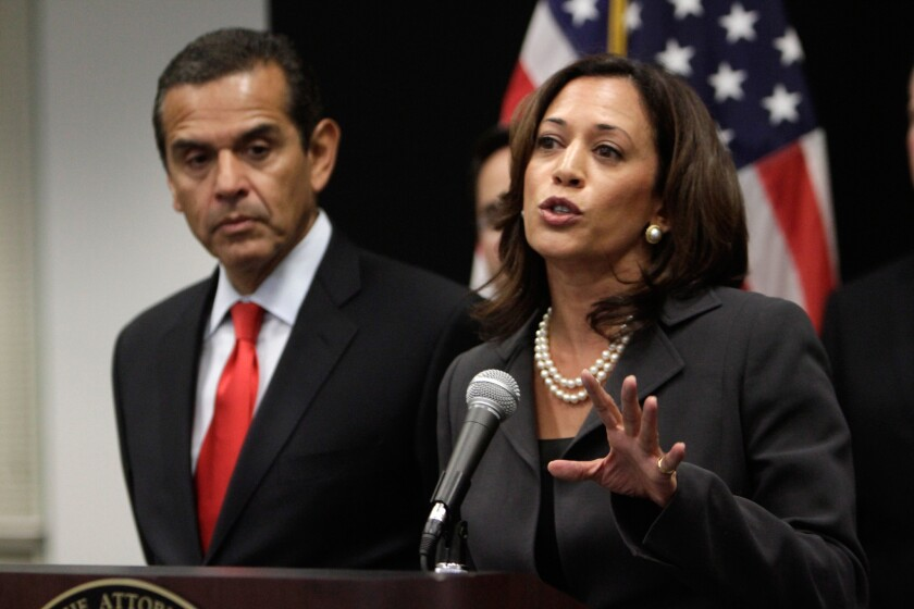 Atty. Gen. Kamala Harris speaks at a news conference on mortgage fraud in May 2011 with Antonio Villaraigosa, then L.A. mayor.