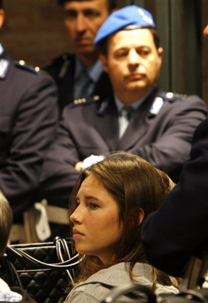 Amanda Knox looks on during the first day of her trial at Perugia's court, central Italy, Friday, Jan. 16, 2009. Knox, an American college student from Seattle, and her Italian former boyfriend Raffaele Sollecito went on trial Friday accused of sexually assaulting and murdering Knox's roommate. (AP