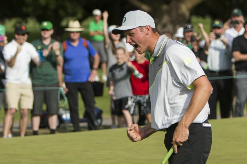 Oregon's Sulman Raza celebrates after making the match winning putt in his semifinal match against Illinois' Charlie Danielson to send Oregon into the finals of the NCAA men's golf championship at Eugene Country Club in Eugene, Ore., Tuesday, May 31, 2016. Oregon will face Texas in the championship