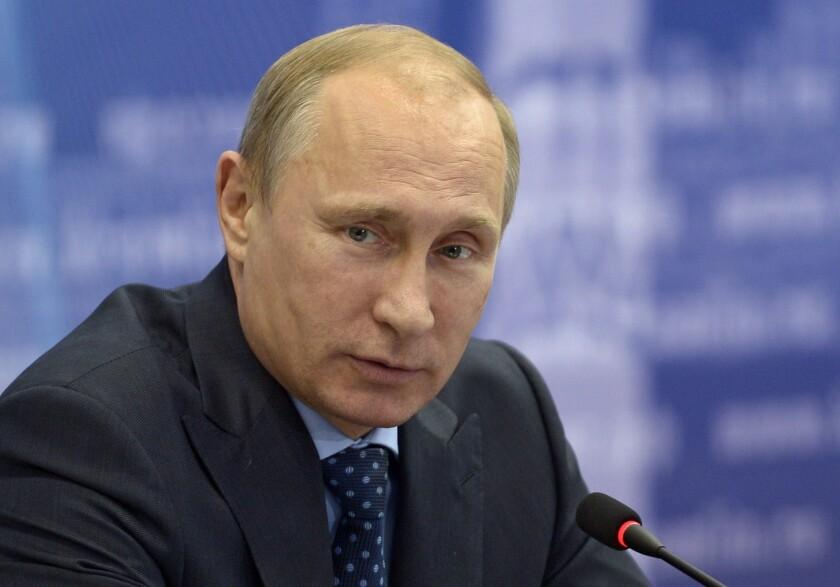 Russia's President Vladimir Putin attends a meeting in the Volga River region of Samara.