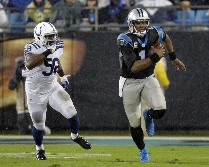 Carolina Panthers' Cam Newton (1) runs as Indianapolis Colts' Trent Cole (58) pursues in the first half of an NFL football game in Charlotte, N.C., Monday, Nov. 2, 2015. (AP Photo/Bob Leverone)