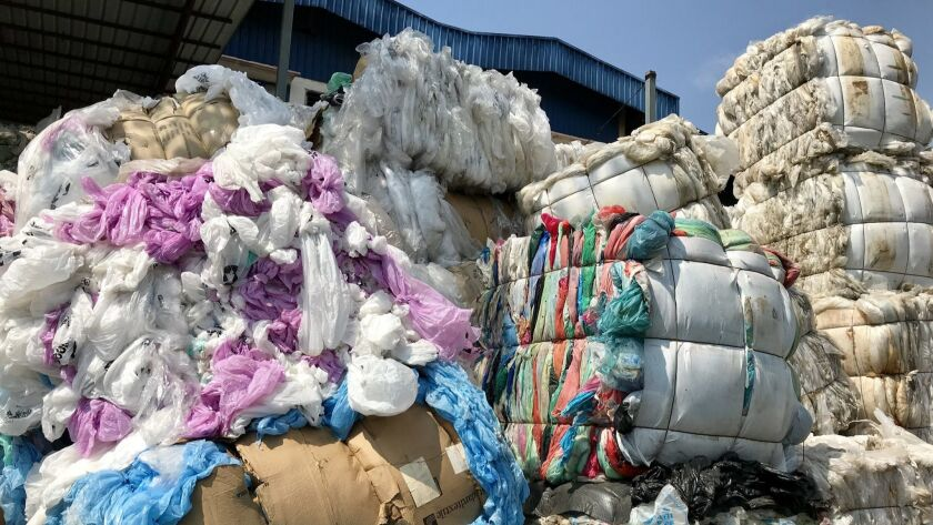 Bales of plastic are stacked outside a recycling plant in Port Klang, Malaysia.