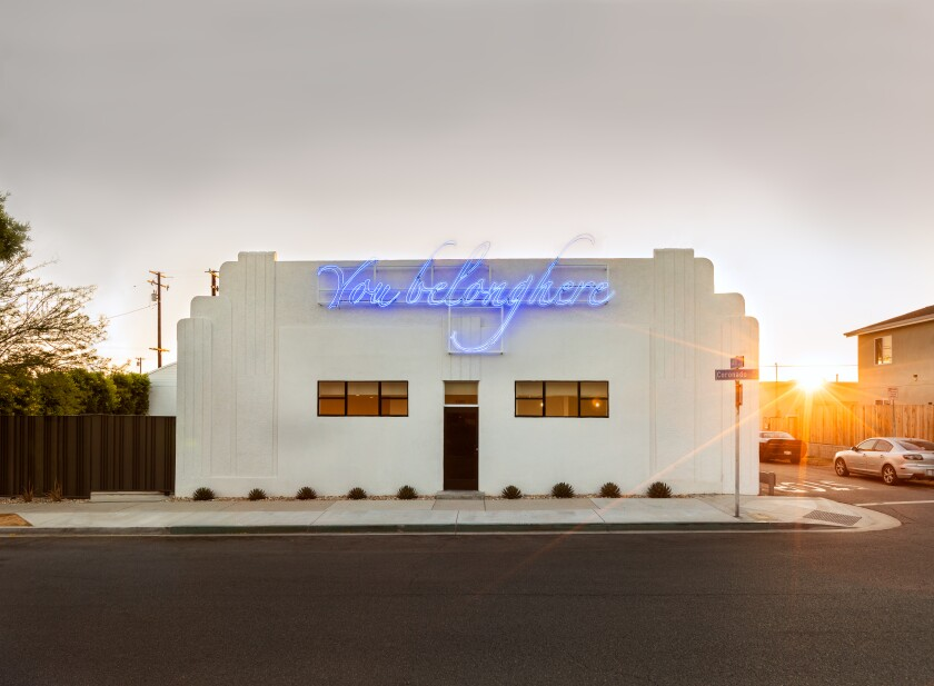 "Tavares Strachan's neon work reads ""You Belong Here"" on the facade of Compound art space."