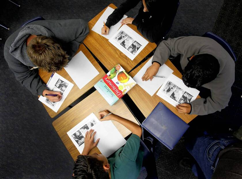 Students work in groups of four during a seventh-grade language arts class at Santiago Elementary School in the Santa Ana Unified district. A main component of Common Core is to encourage group work and develop speaking skills.