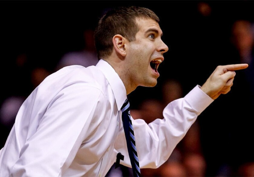 Butler Coach Brad Stevens protests a call during the game against the Rhode Island.