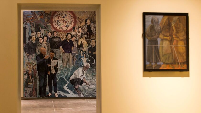 "PASADENA, CA - DECEMBER 05: The mural, ""Winds from Fusang,"" is viewed through a door way at the rece"