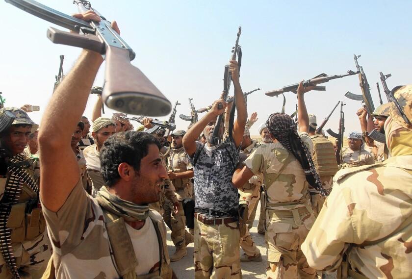 Iraqi fighters celebrate victory