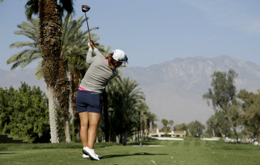 Lydia Ko, of New Zealand, watches her tee shot on the 15th hole during the first round of the LPGA Tour ANA Inspiration golf tournament at Mission Hills Country Club on Thursday, April 2, 2015 in Rancho Mirage, Calif. (AP Photo/Chris Carlson)