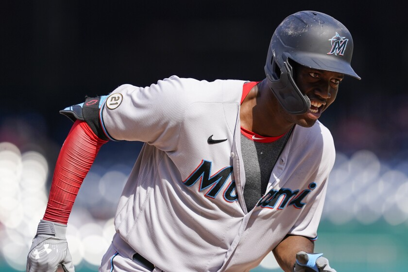 Miami Marlins' Jesus Sanchez celebrates as he runs the bases after hitting a two-run homer during the sixth inning of a baseball game against the Washington Nationals at Nationals Park, Wednesday, Sept. 15, 2021, in Washington. (AP Photo/Alex Brandon)