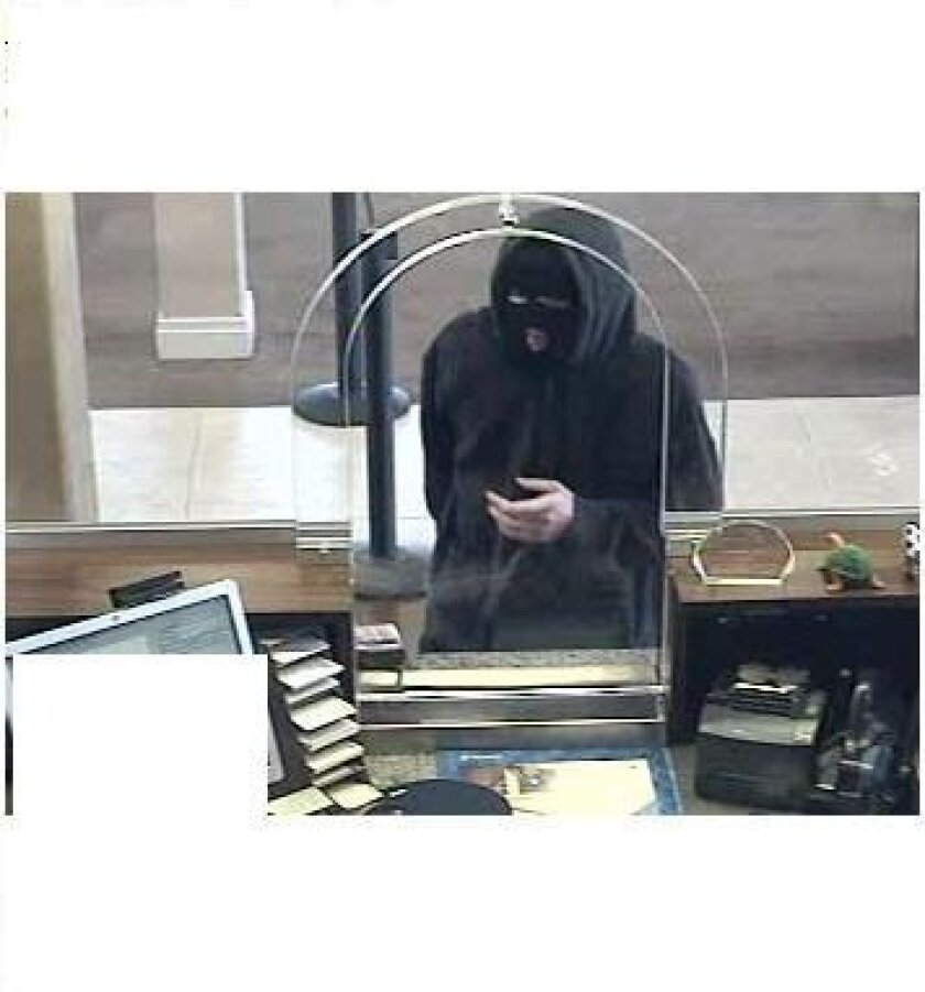 The thief who robbed a Chase Bank branch in Point Loma Saturday is being sought by the FBI and San Diego Police.