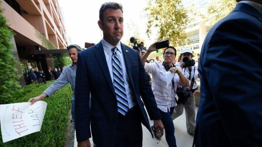 Rep. Duncan Hunter leaves an arraignment hearing in San Diego on Aug. 23.