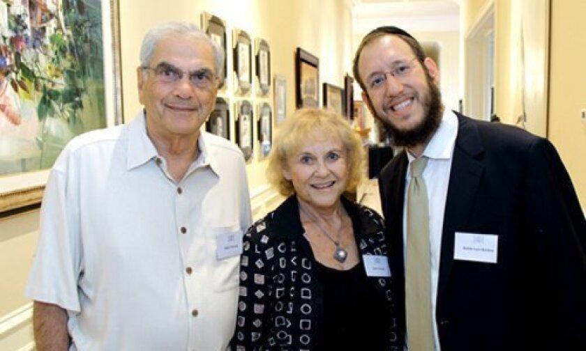 Elliot Tarson, Lynn Tarson, Rabbi Levi Raskin