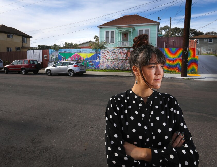 "Local artist Carolyn Osorio organized other artists and created a multi-panel mural in front of where she lives in Barrio Logan. Her panel to the far left side of the mural, ""Tips for Developers Who Want to Gentrify,"" directly addresses the gentrification of the art gallery scene in the neighborhood that have been forced out and replaced by trendy shops."
