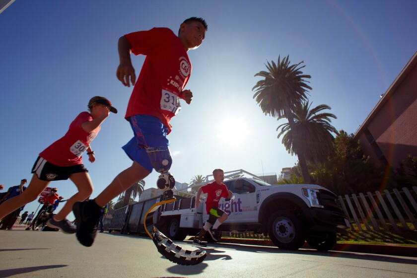 Young children make the first turn on the course during Sunday's Challenged Athlete Foundation, Kids Run at La Jolla Cove.