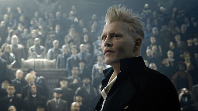 """This image released by Warner Bros. Pictures shows Johnny Depp in a scene from """"Fantastic Beasts: Th"""