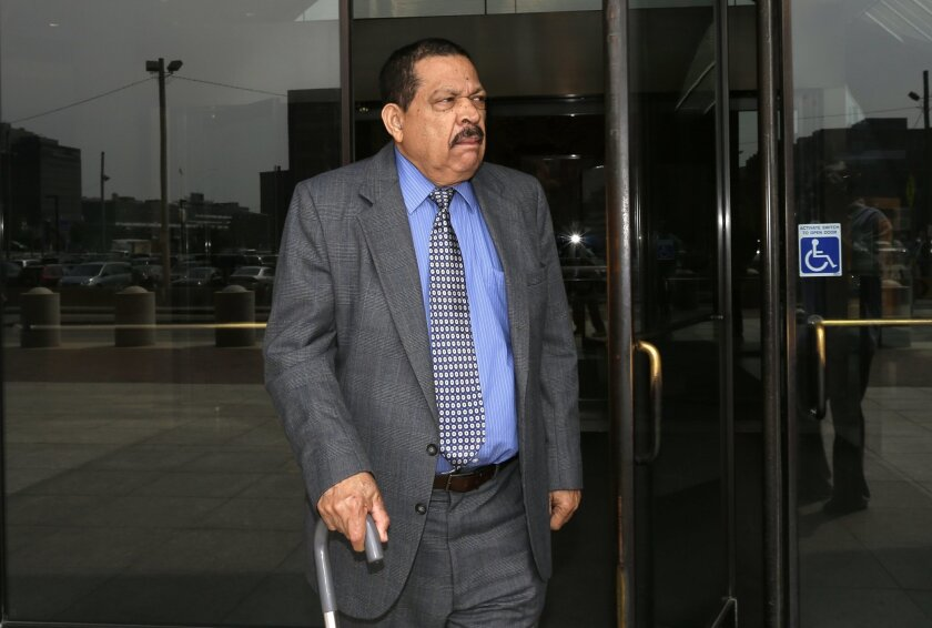 FILE - In this Aug. 22, 2013 file photo, former El Salvadoran military Col. Inocente Orlando Montano departs federal court, in Boston. A court battle in North Carolina could determine whether prosecution will proceed for the notorious slayings of six Jesuit priests more than two decades ago during El Salvador's civil war. An extradition hearing on Wednesday, Aug. 19, 2014, for Morales represents the latest twist in a case that stretches back to 1989. Spain, the home country of five of the priests, is seeking to prosecute Montano there. (AP Photo/Steven Senne, File)