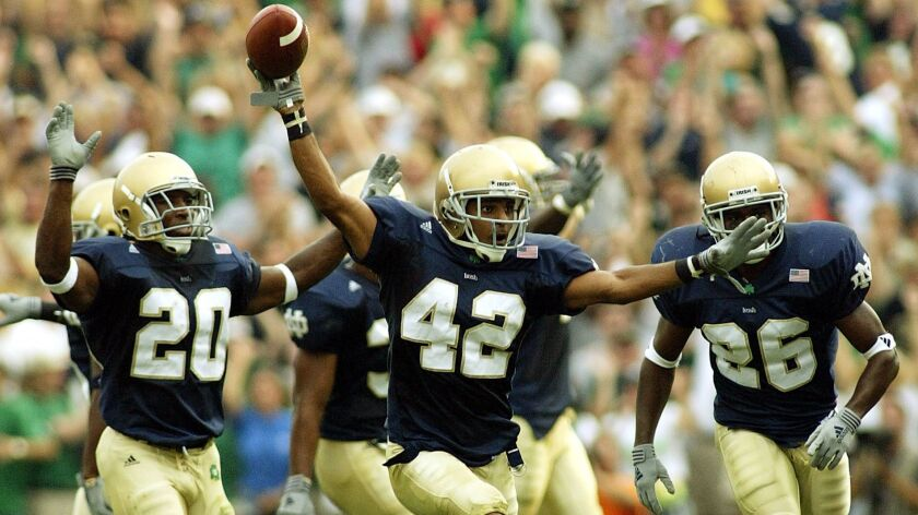 Notre Dame cornerback Shane Walton (42) celebrates his game-sealing interception against No. 7 Michigan in the 25-23 win on Sept. 14, 2002, in South Bend, Ind.