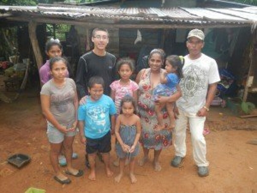 Canyon Crest Academy senior Andrew Deremer with his host family in the community of Nata in Panama.