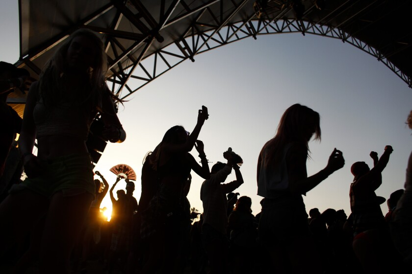 Dancers take in DJ Dillon Francis as the sun sets during the second weekend of the Coachella Valley Music and Arts Festival in Indio.