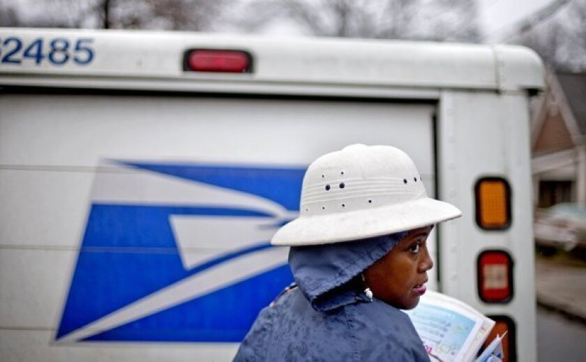 U.S. mail carrier and truck