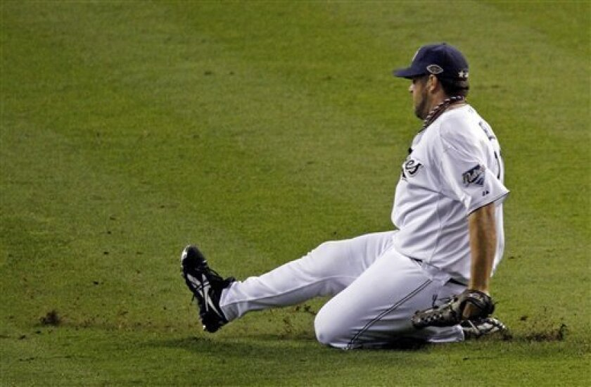 National League's Heath Bell of the San Diego Padres slides into the infield before pitching during the eighth inning of the MLB All-Star baseball game Tuesday, July 12, 2011, in Phoenix. The National League won 5-1. (AP Photo/Ross D. Franklin)
