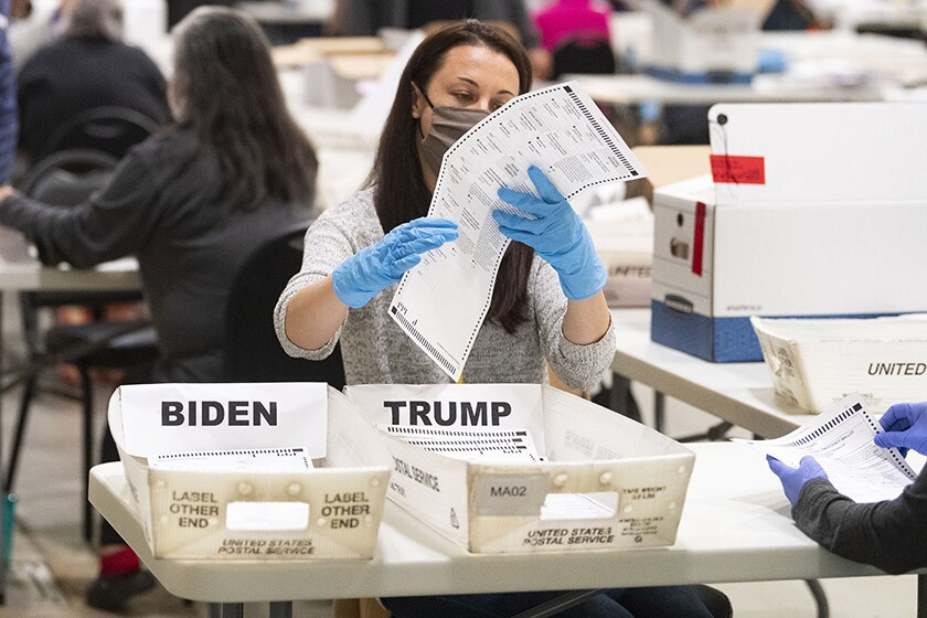 A worker takes part in a hand recount of presidential votes in Marietta, Ga., on Nov. 15 for a state audit.