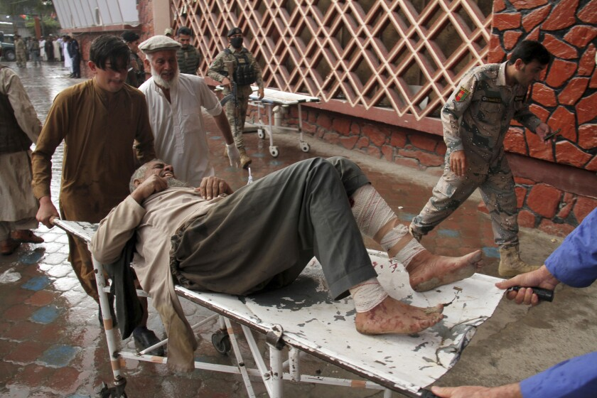 A wounded man is brought into a hospital in Jalalabad