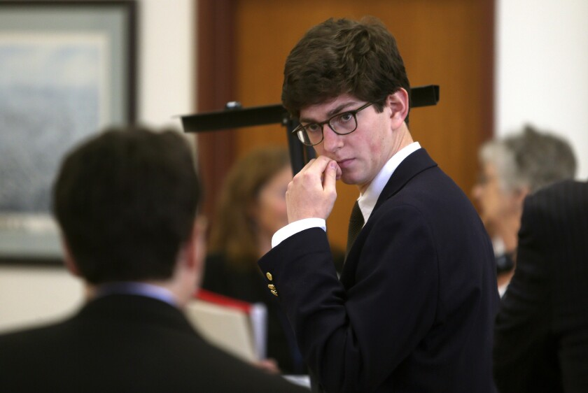 Former St. Paul's student Owen Labrie confers with his lawyer before the start of the second day of his trial at Merrimack County Superior Court in Concord, N.H., on Aug. 19, 2015.