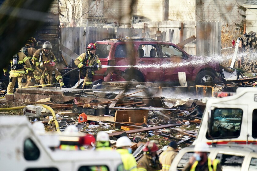 Firefighters work the scene of a deadly explosion that leveled a home in Omaha, Neb., Tuesday, Dec. 8, 2020. (AP Photo/Nati Harnik)