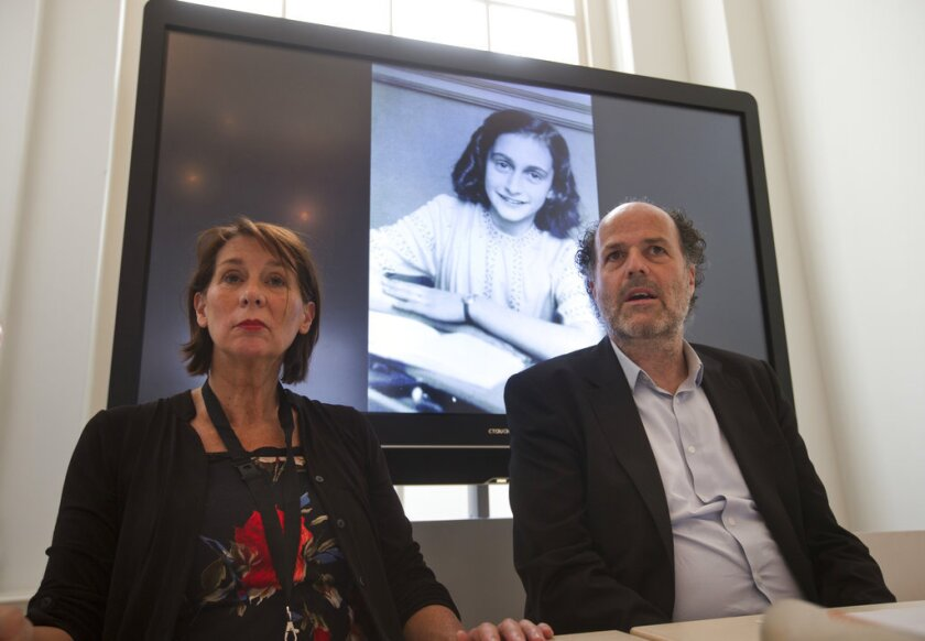 """Teresien da Silva, left, and Ronald Leopold of the Anne Frank Foundation wait for the start of their press conference where the Foundation and two Dutch historical institutes promised to announce """"new information about the diary"""" at the Anne Frank House in Amsterdam, Netherlands, Tuesday, May 15, 2018."""