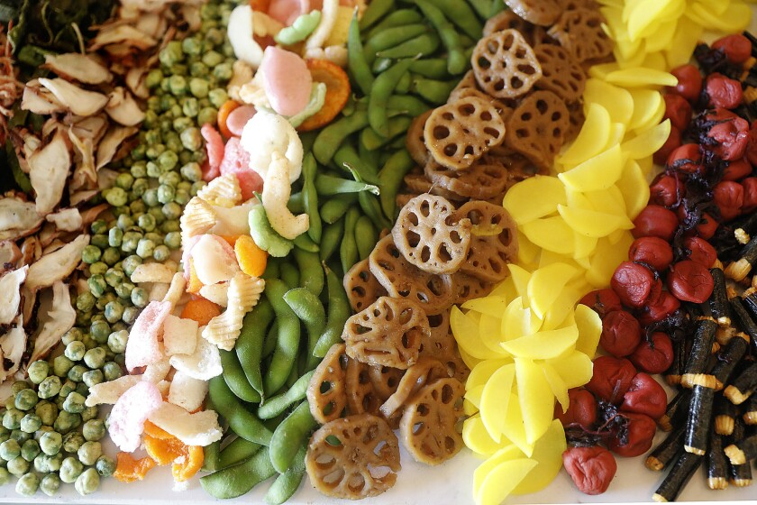 A Japanese mezze platter made of Japanese snacks is served at the home of Ann Soh Woods, founder of Kikori whiskey.