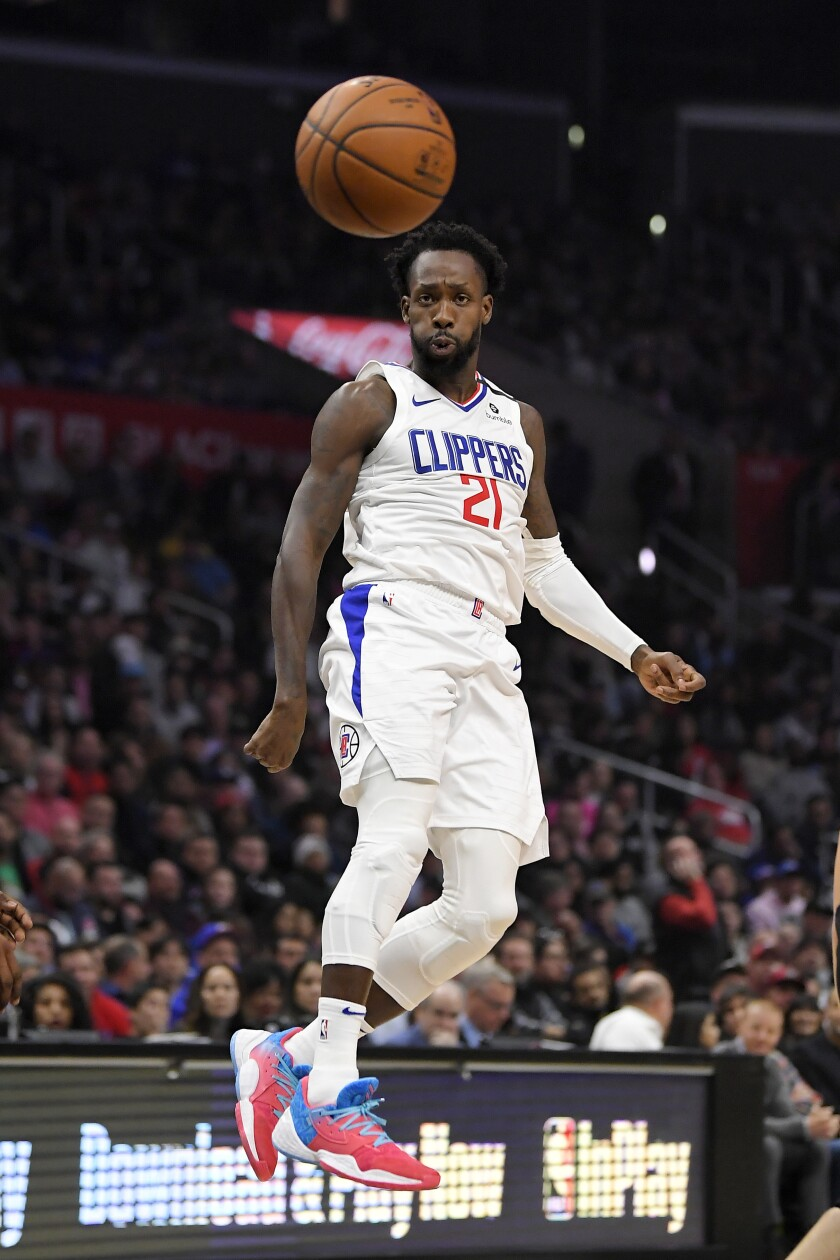 Clippers guard Patrick Beverley passes the ball during the first quarter against the Miami Heat on Feb. 5 at Staples Center. He was injured in the third quarter.