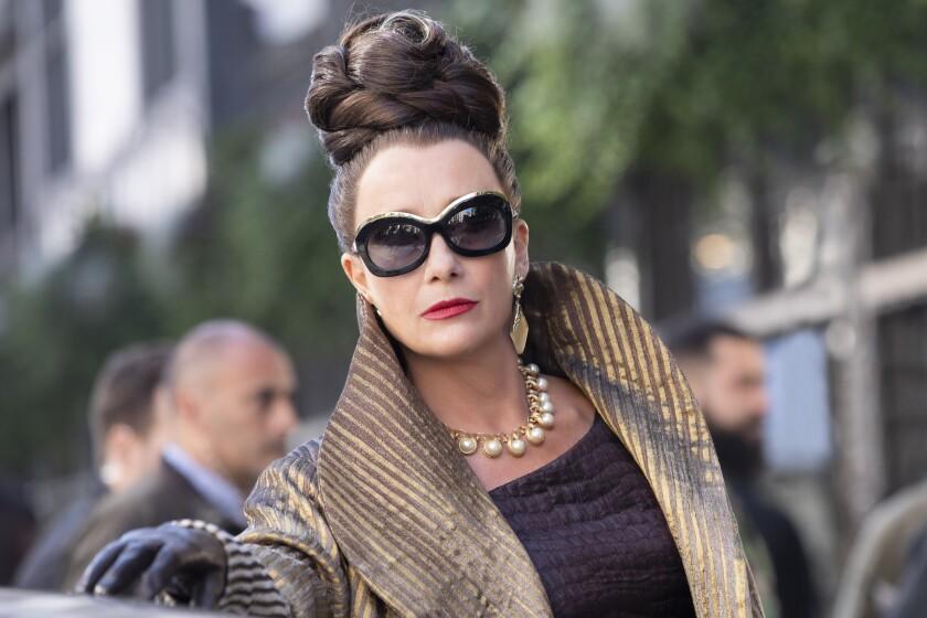"Emma Thompson glares through chic sunglasses in ""Cruella."""