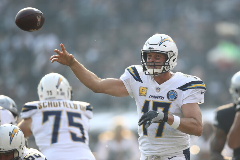 Philip Rivers #17 of the Los Angeles Chargers attempts a pass against the Oakland Raiders during their NFL game at Oakland-Alameda County Coliseum on November 11, 2018 in Oakland, California.