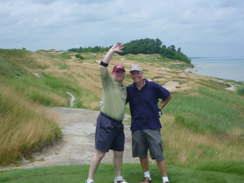 Paul Laubach (left) poses with his friend Scott Rand during a round at Whistling Straits.