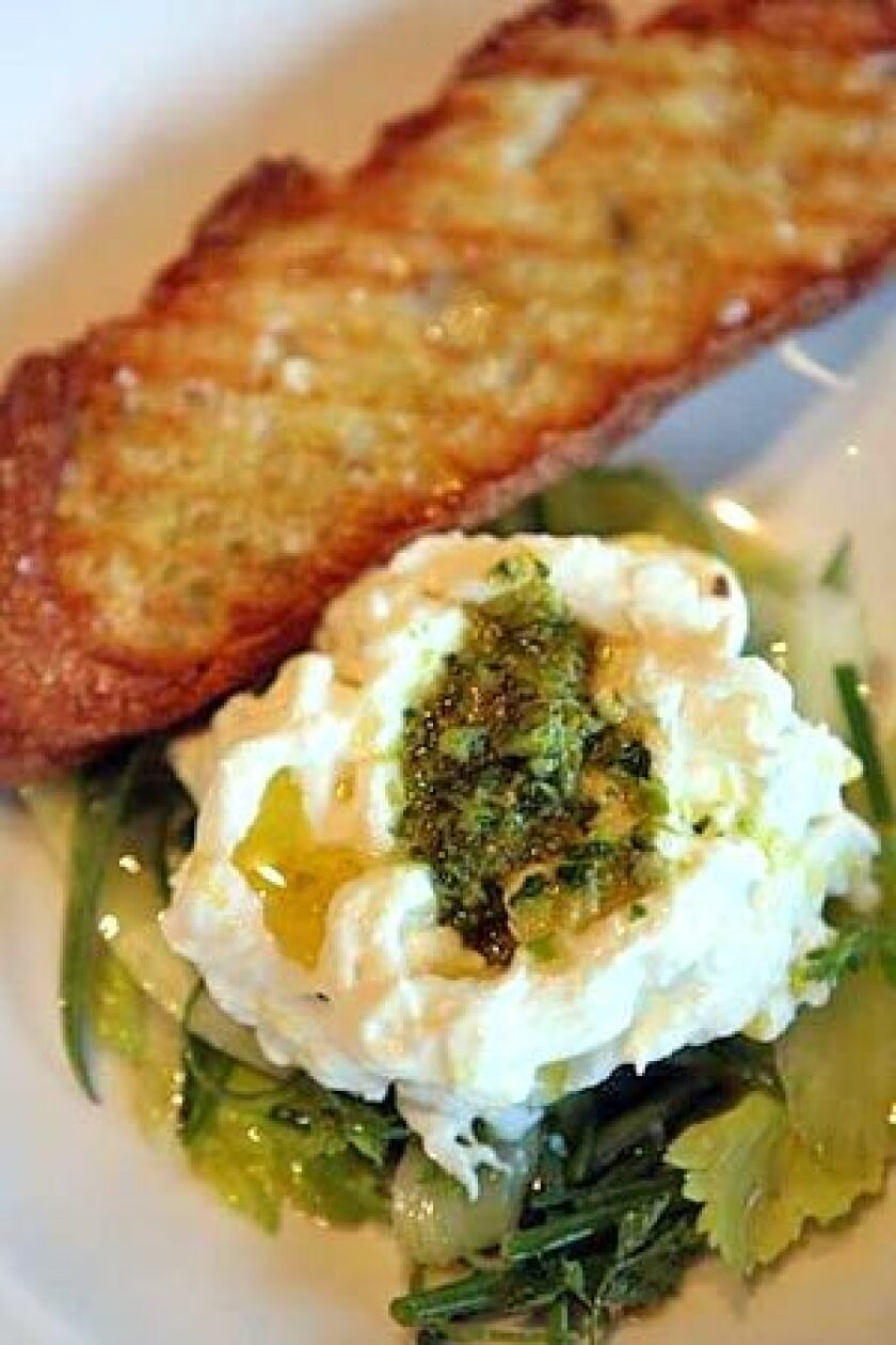 FROM THE MOZZA BAR: Stracciatella with celery and herbs.