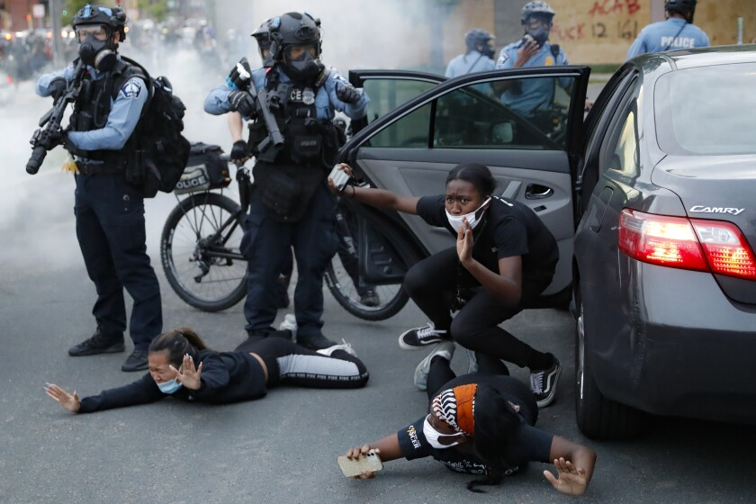 Motorists are ordered to the ground during a protest in Minneapolis over the death of George Floyd