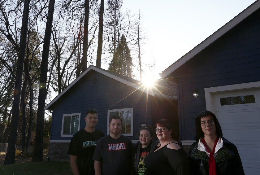 Victoria Sinclaire, second from right, and her family rebuilt their home in Paradise, Calif.