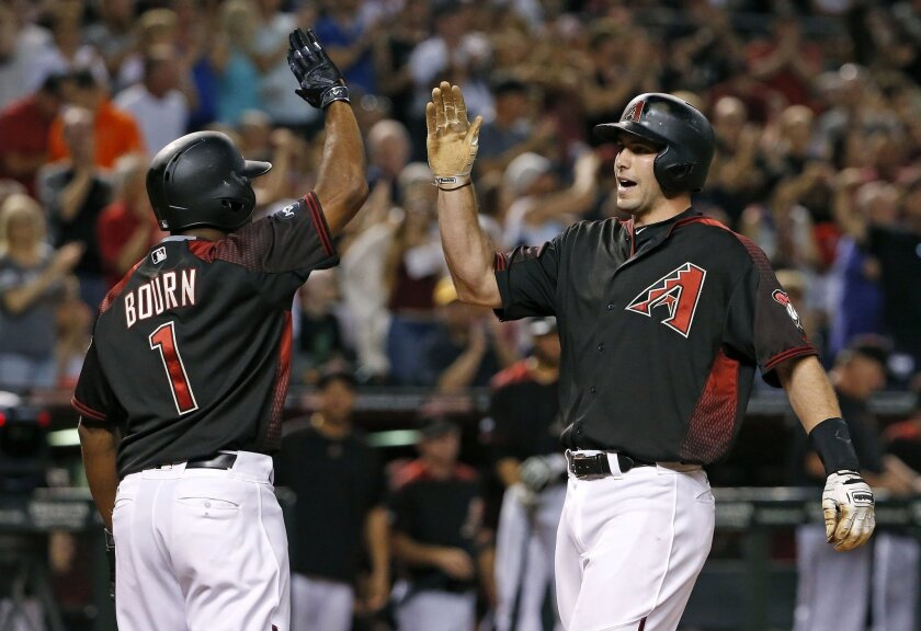 Arizona Diamondbacks' Paul Goldschmidt, right, celebrates his two-run home run against the San Diego Padres with Michael Bourn (1) during the second inning of a baseball game Saturday, May 28, 2016, in Phoenix. (AP Photo/Ross D. Franklin)